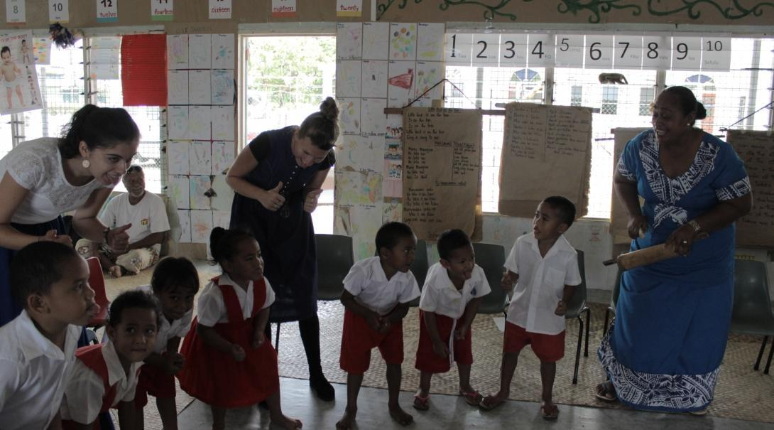 Volunteers teaching in Samoa facilitate a classroom game.